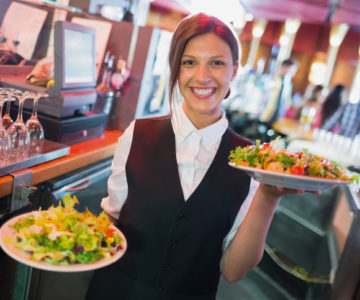 Waitress serving food
